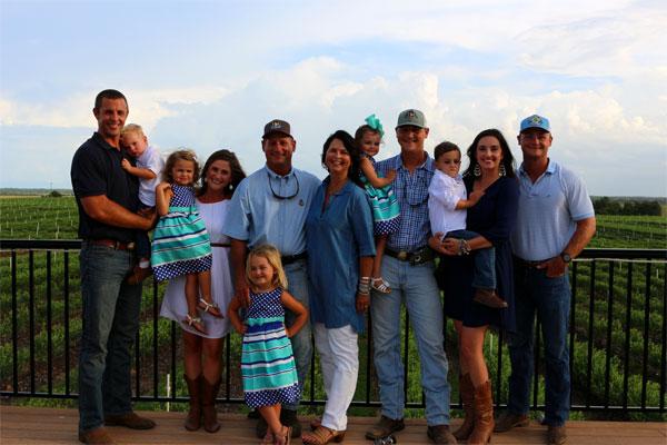 H&A Farms family photo at blueberry farm